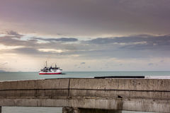 Take a look at the ferryboat cruising the upper sea from the bri. Dge Stock Image
