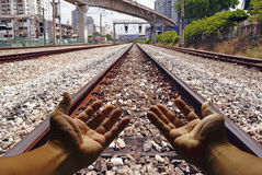 Take me home. A digitally altered image showing a hand pleading the rail-road to lead him home royalty free stock images