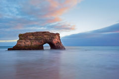 Take Me There, Natural Bridges, Santa Cruz. A slow shutter smooths the evening waves at Natural Bridges State Park in Santa Cruz as the last light of the day Royalty Free Stock Image