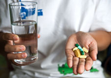 Take medicine Stock Photo