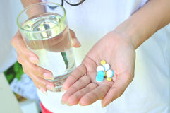 Take medicine and water Royalty Free Stock Photo