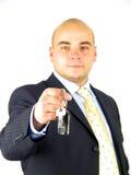 Take mine. Man holding keys royalty free stock photo