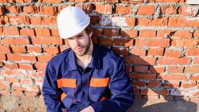 Guy protective helmet bearded handsome builder. Take minute to relax. Man take break working day at construction site stock photography