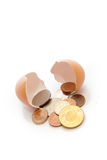 Take money from egg shell Royalty Free Stock Photos
