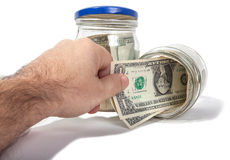 Take money out of moneyboxes isolated Royalty Free Stock Images