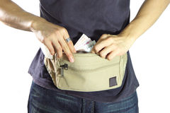 Take money from waist belt bag Stock Photography