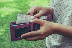Take money from the wallet Royalty Free Stock Photo