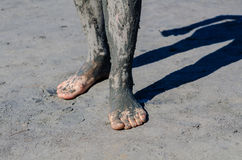 Take a mud cure. healthy medical procedure. dirty legs Stock Images
