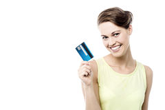 Take my cash card !. Beautiful woman showing her new credit card Stock Photos