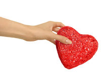 Take my heart. Female hand holding a big red heart, isolated on white Stock Photos