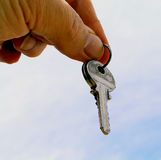 Take my Keys. Man giving Keys Stock Photo