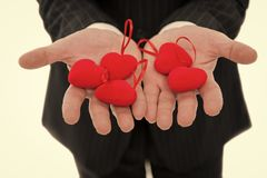 Take my love. Hands holding red hearts. Male open palms with love symbol close up. Love and valentines day concept. Valentines day souvenir. Cute soft red stock photos