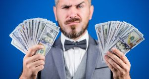 Take my money. Gain real money. Richness and wellbeing concept. Cash transaction business. Easy cash loan. Man formal. Suit hold many dollar banknotes blue stock photos