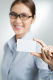 Take my visiting card. A businesswoman holding a visiting hand on the foreground Royalty Free Stock Image