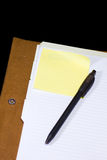 Take a note. A blank page with a pen on post it for writing some notes (isolated with path Stock Photo