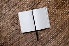 Take notes. Opened empty notebook with black bookmark on rmat, close up Stock Photography