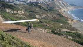 The Take Off. Hang glider taking running start for lift off from bluffs south of San Francisco Stock Images