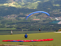 Take off. Paraglider taking off from a cliff stock photography