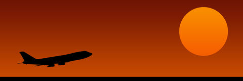 Take-off. Black airplanes silhouette with orange sun Stock Photography