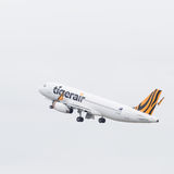 Take off airbus A320-232 Tiger Airways Royalty Free Stock Photo