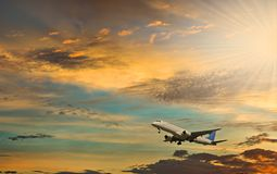 Take off. Airplane at dawn. Sunshine with beams. Conceptual image symbolizing travel industry and tourism Stock Photo