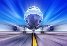 Take off. Airplane on a runway while take off Royalty Free Stock Photo