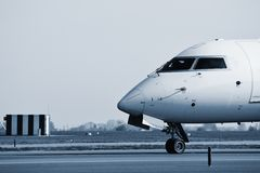 Take off. Airplane is taxiing to take off - blue toned Royalty Free Stock Photography