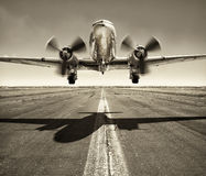 Take off. Old airplane while take off Royalty Free Stock Photo