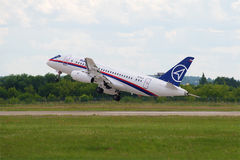 Take-off passenger aircraft Sukhoi Superjet 100 leaves in the right turn. Zhukovsky Airport, MAKS-2017 Air Show. ZHUKOVSKY, RUSSIA - JULY 20, 2017: Take-off Royalty Free Stock Photo