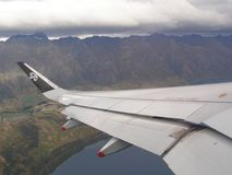 Airport Queenstown New Zealand Take-off Remarkables. Take off from Queenstown New Zealand with the spectacular view over The Remarkables. On the wing there is a Royalty Free Stock Images