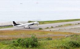 Take off of A SAAB 2000s aircraft of Pen Air at Tom Madsen, Dutc. Dutch Harbor, Unalaska, Alaska, USA - August 14th, 2017: A SAAB 2000s aircraft of Pen Air is Stock Photos