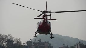Take off of a small helicopter from the ground stock video footage