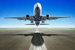 Take off. Of an modern airliner against a blue sky royalty free stock image