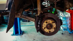 Car maintenance in tire service center royalty free stock photography