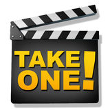 Take one. Film slate with the words take one representing film and cinema productions and hollywood reviews of new movies and telivision shows Royalty Free Stock Photos
