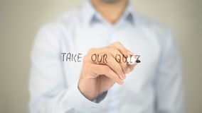 Take Our Quiz , man writing on transparent screen. High quality Royalty Free Stock Photography