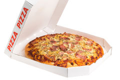 Take out box pineapple and ham Hawaiian pizza. Take out box of a pineapple and ham Hawaiian pizza - studio shot with a white background Royalty Free Stock Image