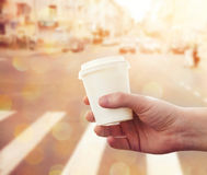 Take-out coffee at city street Royalty Free Stock Photography