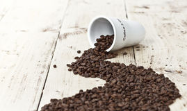 Take out coffee cup full of beans Stock Photography