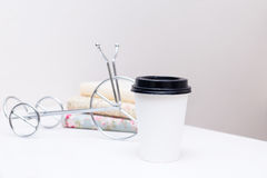 Take-out coffee in thermo white cup at the table royalty free stock photo