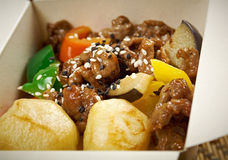 Take-out food - Beef slice  and potato. Take-out food -Beef slice  and potato.chinese cuisine in take-out box Stock Image