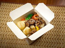 Take-out food - Beef slice  and potato. Take-out food -Beef slice  and potato.chinese cuisine in take-out box Royalty Free Stock Photos