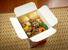 Take-out food - Beef slice  and potato. Take-out food -Beef slice  and potato.chinese cuisine in take-out box Royalty Free Stock Images