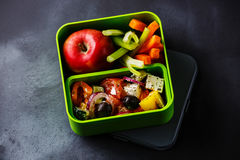 Take out food Greek salad and Apple fruit in Lunch box Stock Photo