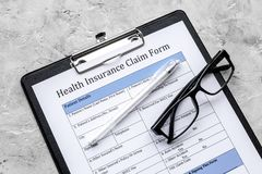 Take out health insurance. Document, pad, pen on grey background top view Royalty Free Stock Image