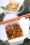 Take Out Noodles. BBQ egg noodles and vegetable noodles in take away containers Royalty Free Stock Images
