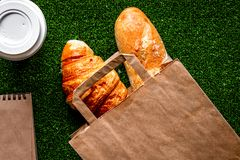 Take out in paper bag on green background top view Stock Images