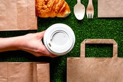 Take out in paper bag on green background top view Royalty Free Stock Photography