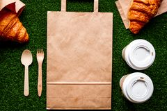 Take out in paper bag on green background top view Stock Photo