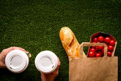 Take out in paper bag on green background top view stock photography